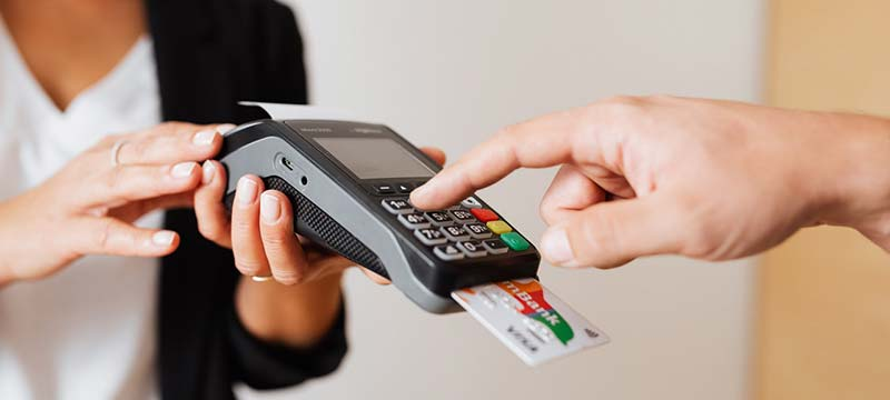 Person using a credit card reader for a purchase